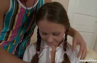 Pigtailed teen gets fucked and cummed