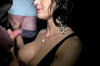 Milf dogging in the woods sucking lots of cocks