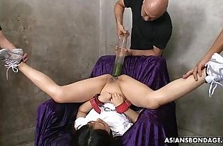 Filling her ass and pussy with all kinds of liquids