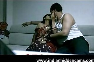 mature couple in lounge after party seducing each other sexual desire